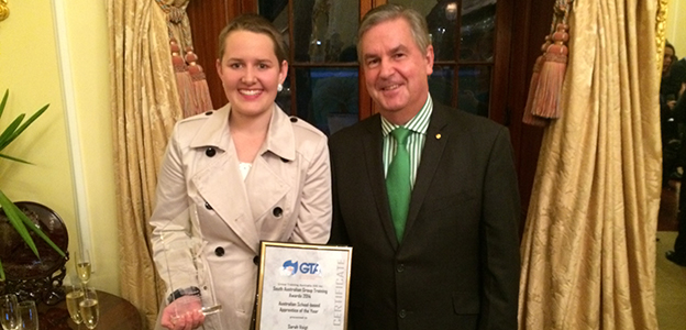Sarah Voigt receives her award from His Excellency the Governor of South Australia, RDML Kevin Scarce.