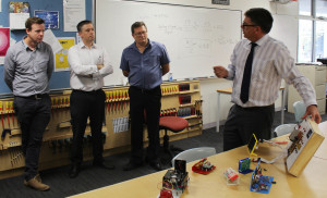 Staff from Defence Science and Technology Group list to Information Technology teacher Michael Gauci during their visit StPatsTech.