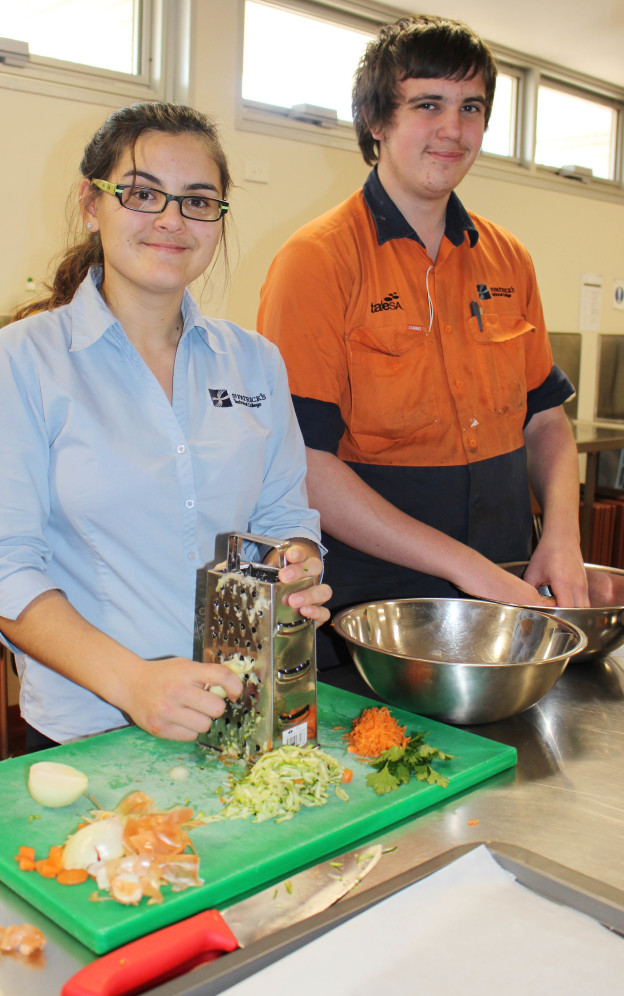 Herbertia Barber-Watts and Jack Felton learning to cook sausage rolls as part of their Health studies.