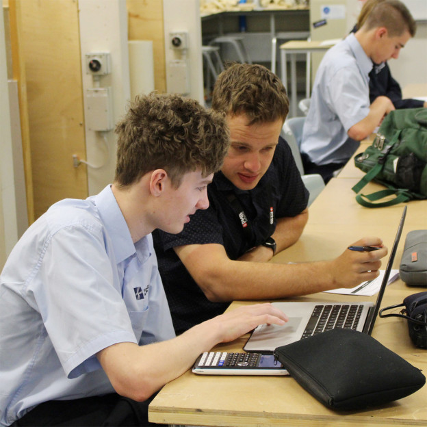 Peter Branson, Project Engineer with PMB Defence, and Year 11 Electrotech student Kai Rogan working through lead battery theory.
